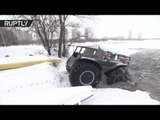 Off-road monster: Russian all-terrain vehicle drives across ice and into water to save lives