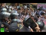 Unwelcome again: Scuffles at anti-Obama protest as Peru hosts APEC economic summit
