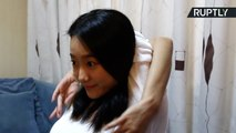 Chinese Contortionist Able to Twist Arms Nearly 360 Degrees