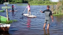 Plastic bottles used to make paddle boards to clean Brazil beach