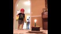 Ce gamin éteint la bougie de son gateau en tirant dans son ballon.. Fake or not?