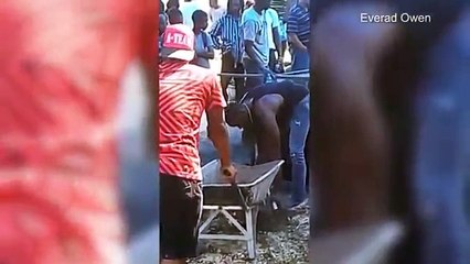Usain Bolt Helps Dig Grave for Team Jamaica's Germaine Mason