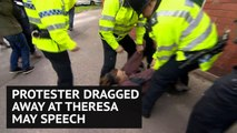 Fox hunting protester dragged along ground by police at Theresa May speech