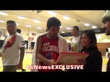 Manny Pacquiao THE PEOPLE'S CHAMP; signs ART PIECE for FAN - EsNews Boxing