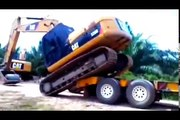equipment loading fails, loading and unloading heavy equipment, loading trucks with excava