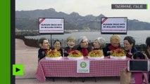 G7 : des militants se déguisent en dirigeants des grandes puissances se gavant de spaghettis