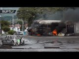 Hijacking & Molotov Cocktails: Venezuelan protesters set vehicles on fire, clash with police