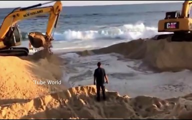 Super Power Excavators Making Canals through water from the