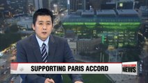 Seoul City Hall lights up in green showing support for Paris accord