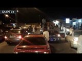Libyans celebrate Gaddafi's son's release from prison on Ghat's streets
