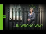 Over here, Theresa: UK's new PM gets muddled up leaving Downing St