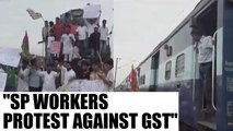 GST rollout : SP workers protest against the launch | Oneindia News