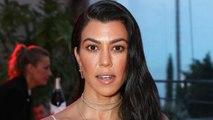 Kourtney Kardashian Wears Sheer Mesh Star Swimsuit While on Vacation