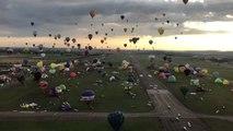 Hot Air Balloons Fill Morning Sky Above Chambley-Bussières Air Base
