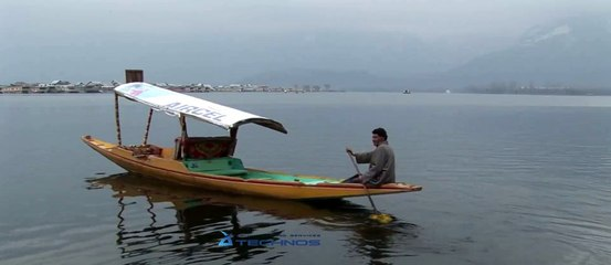 Tourists enjoy shikara ride on Dal Lake in Srinagar