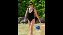 Bells Tiffani Amber Thiessen shows off in plunging swimsuit in Hawaii