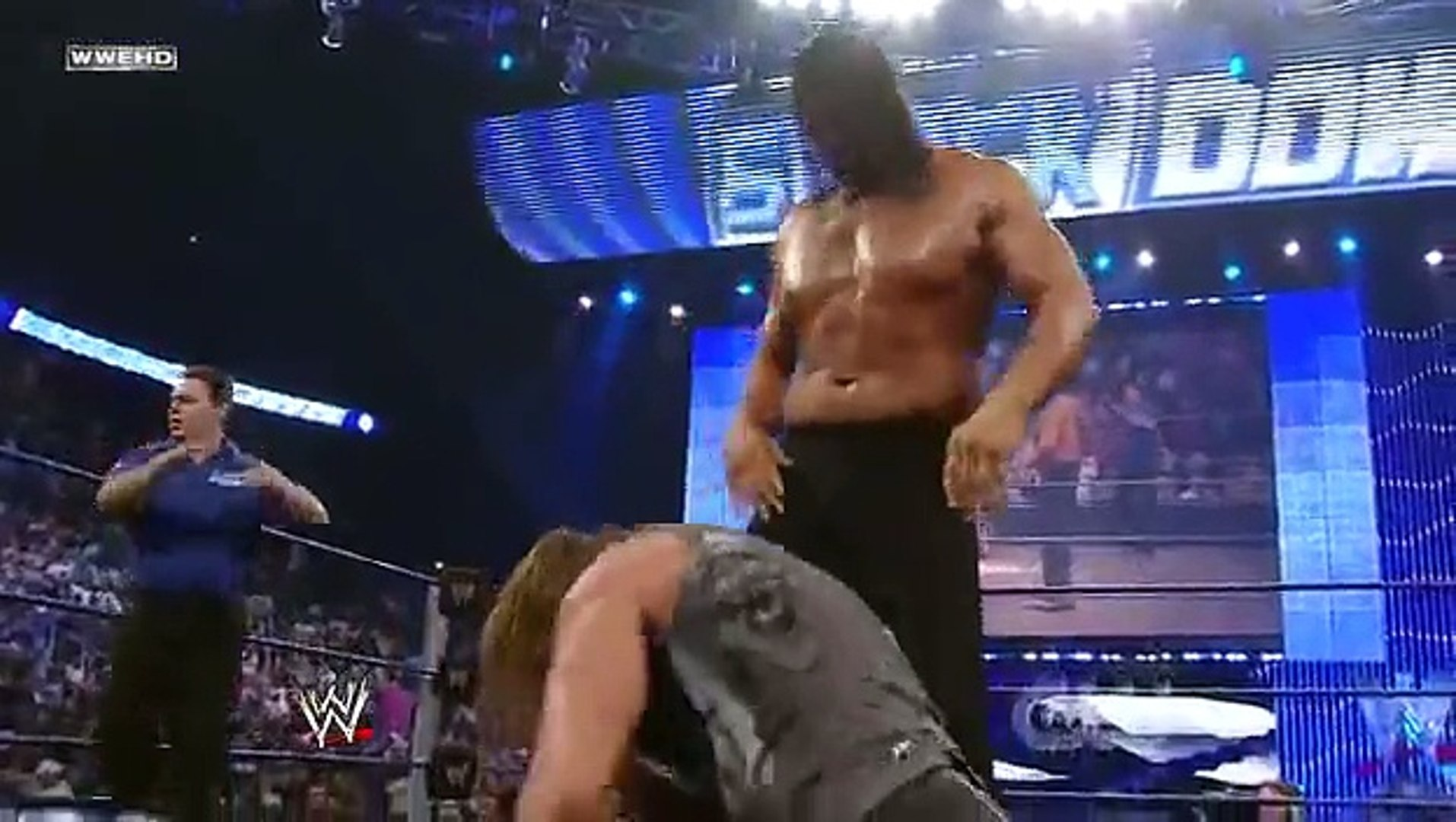 Triple H vs. The Great Khali - Broken Glass Arm Wrestling