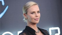 Charlize Theron Cracks Her Teeth