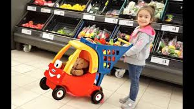 Little girl Doing Shopping  - Kids Size Cozy Coupe Shopping Cart- Nursery Rhymes