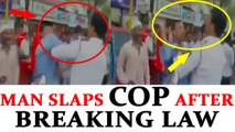 Thane man slaps traffic cop for being stopped as he jumps red light, Watch | Oneindia News