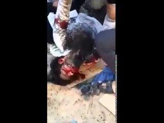 """شاهد   """"داعش"""" ترتكب مذبحة بشعة وتصنع تلال من جثث الاطفال والنساء بالعراق"""