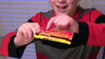 11-yr-old eats Chocolate Bar From Hell, Ghost Pepper jerky and more!! : Crude Brothers