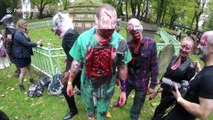 Zombies walk through the streets of London for charity