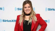Kelly Clarkson Explains Why She is Judging 'The Voice' Instead of 'American Idol' | Billboard News