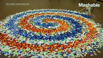 This triple spiral of 15,000 dominoes falling down is incredibly satisfying to watch