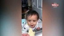 Camın arkasındaki cipsi yemeye çalışan çaresiz bebek!