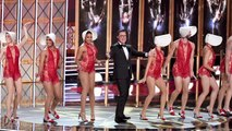 Stephen Colbert Makes a Splash With Musical Number, President Trump Jokes, & Sean Spicer Appearance | THR News