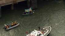 Greenpeace protesters climb aboard boat