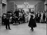 Charlie Chaplin and Edna Purviance dancing in The Count (1916)