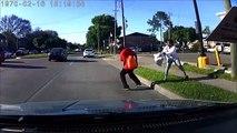 Elle pousse son mari sous les roues d'une voiture pendant une dispute