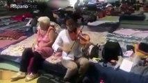 Violinista regala su música los damnificados del terremoto en México