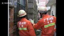 Firefighters free Chinese boy wedged tight between walls