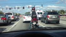 WORLDS BEST Motorcycle Popping Locking and Dropping it, at a Stop light