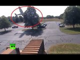 RAW: Moment plane crashes into tree in US parking lot caught on CCTV