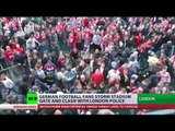 'We're back': German football fans storm stadium gate & clash with London police