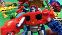 Transformers Rescue Bots Optimus Prime Bumblebee Dinobots Battle the Dinotrux in Robot Battle Slam