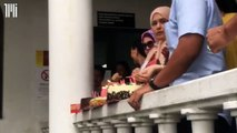 Shafie's supporters bring a cake to the court house