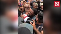 Black protester hugs Neo-Nazi outside Richard Spencer event