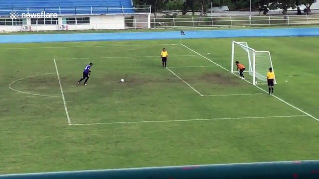 Hilarious moment goalkeeper celebrates penalty save before ball bounces back into goal