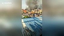 Firefighters tackle huge blaze at Mumbai slum