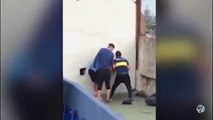 HILARIOUS! Boca Juniors Fan Gets STUCK in Hole In Wall Trying To Sneak Through Bombonera Stadium