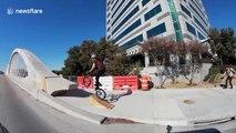 BMX biker rides over Ft. Worth 7th Street Bridge arches