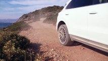 Porsche Cayenne in White Driving off road