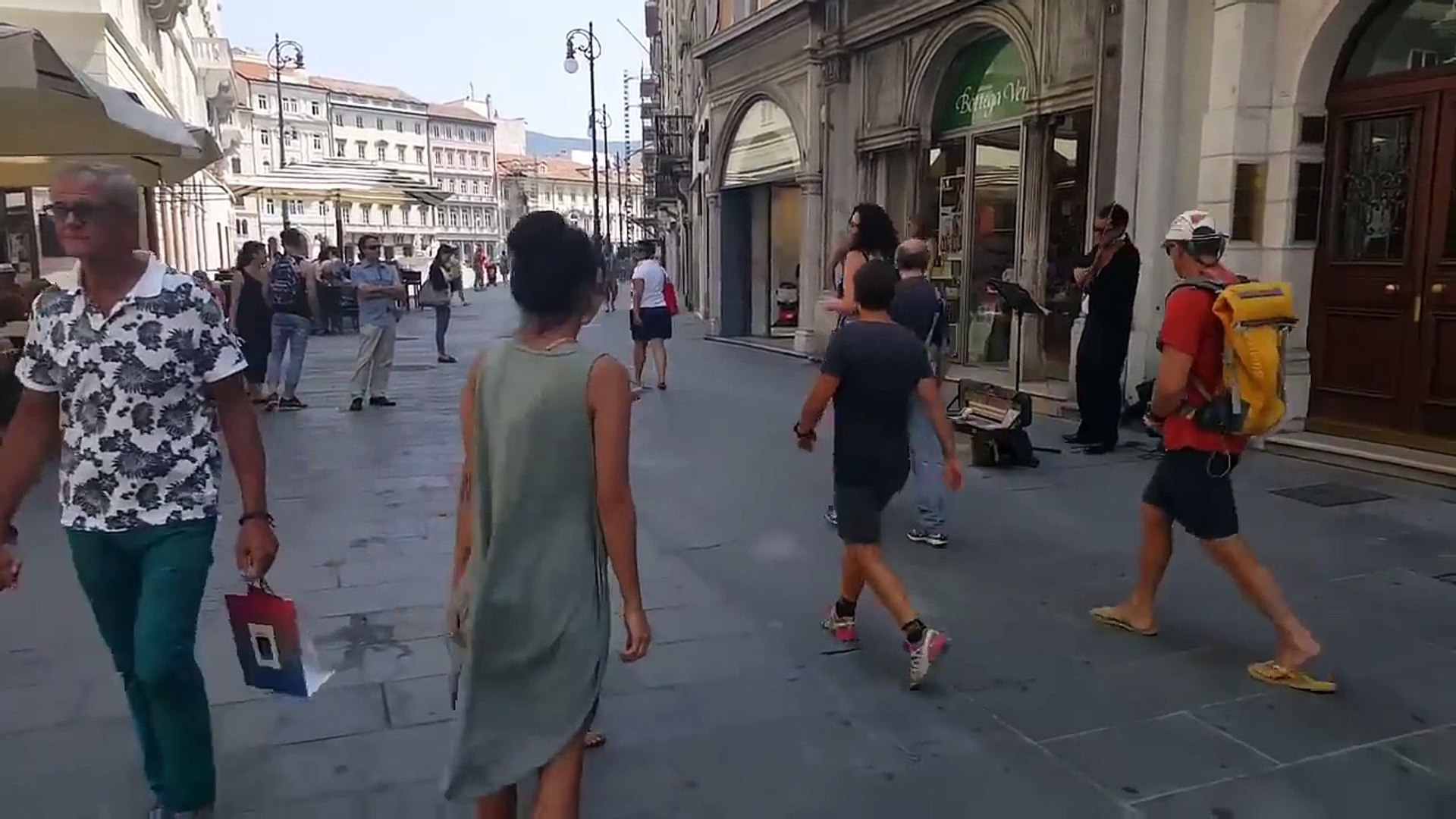The ballerina could not resist the melody of a street musician in Italy