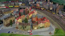 Model Railroad Layout by Modelspoor Group Nienoord with Miniature Cars and more than 100 Trains in HO Scale