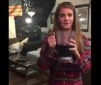 Une fille tente de boite une bouteille de vin cul sec !
